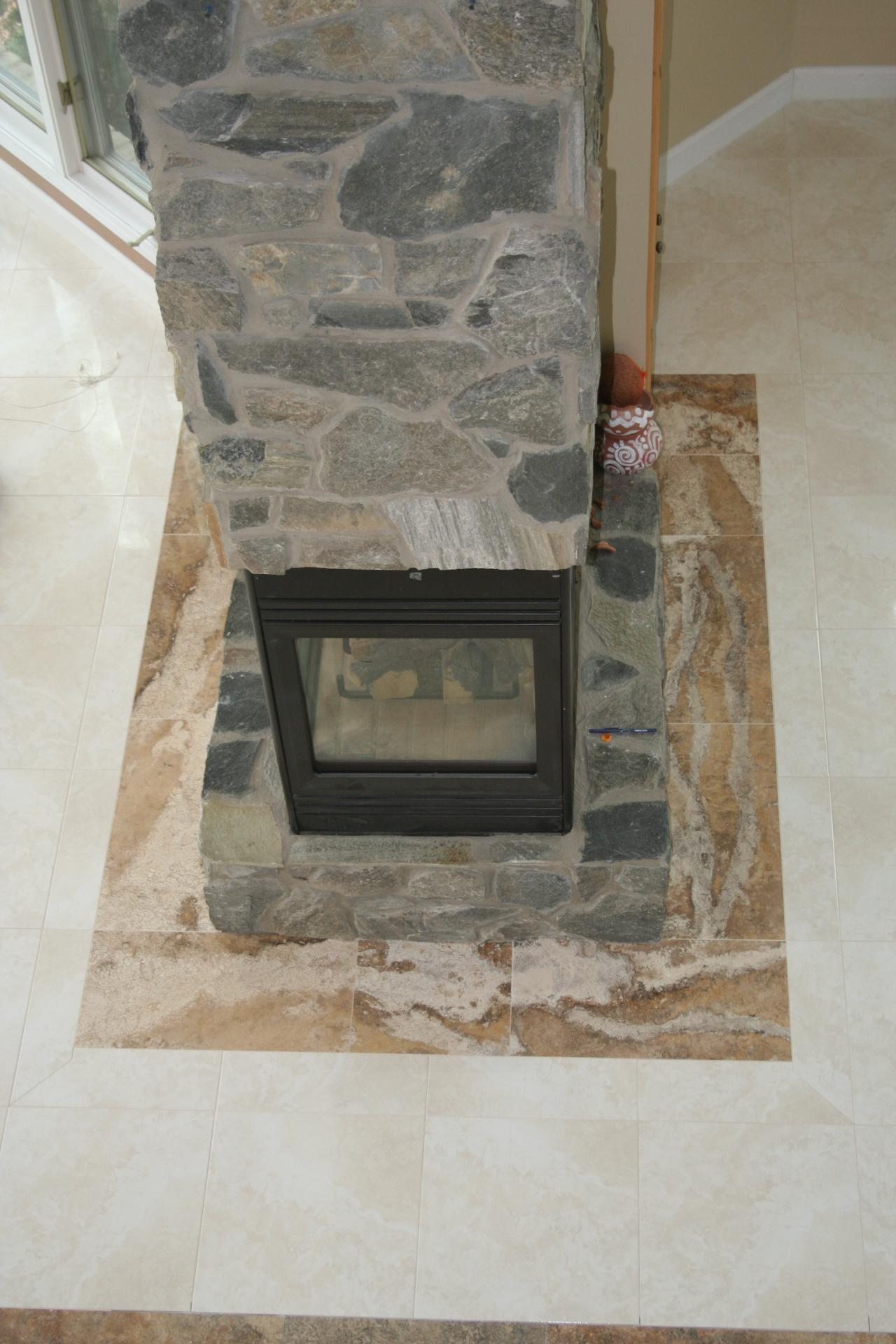 Nest homes construction floor and wall tile designs large format tile fireplace with travertine border dailygadgetfo Images