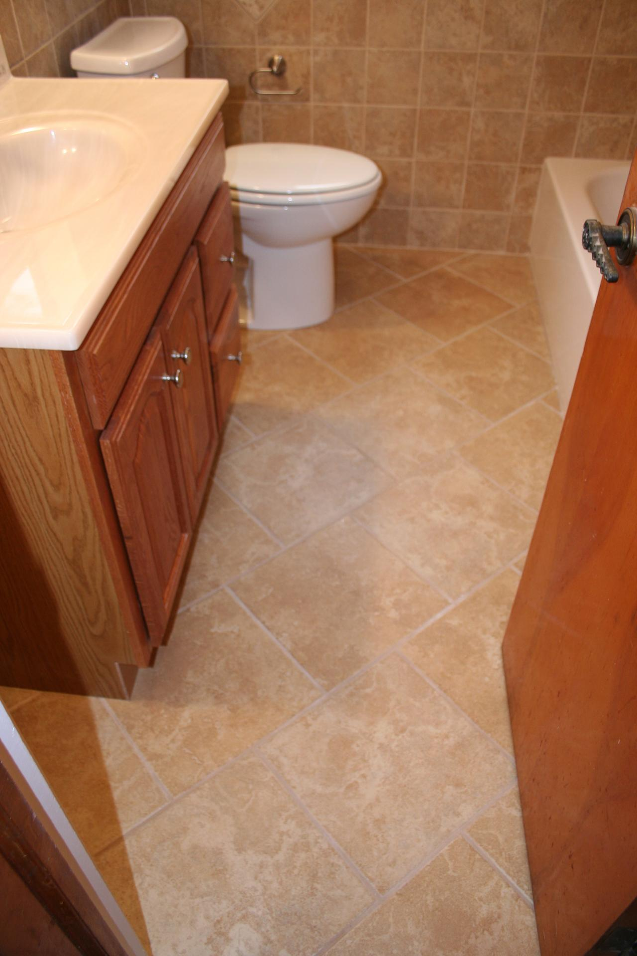 Small Bathroom Diagonal 12 Inch Offset Tile Floor.