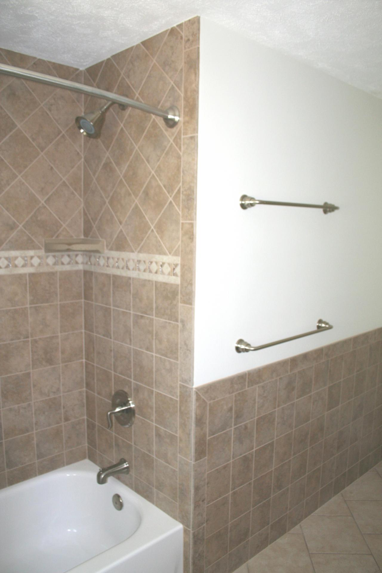 Nest homes construction floor and wall tile designs Bathroom tile showers